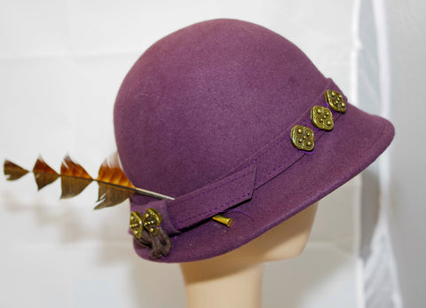 Purple Felt Hat With Cut Feather And Metal Motif On The Hatband