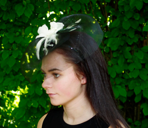 Black Fascinator with White Feather Decoration and Net Veil