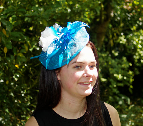 Turquoise Fascinator with Feather Decoration