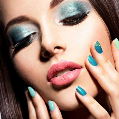 blue eye shadow and nails on beautiful lady raw beauty minerals