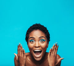 excited black woman with bright blue background