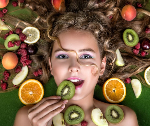 girl face with fruit slices around her
