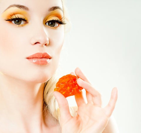 fall beauty trends with colorful eye shadow in orange