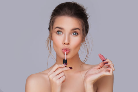 girl applying natural lip gloss for raw beauty minerals