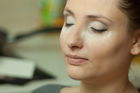 makeup trend called baking women sitting as her makeup bakes