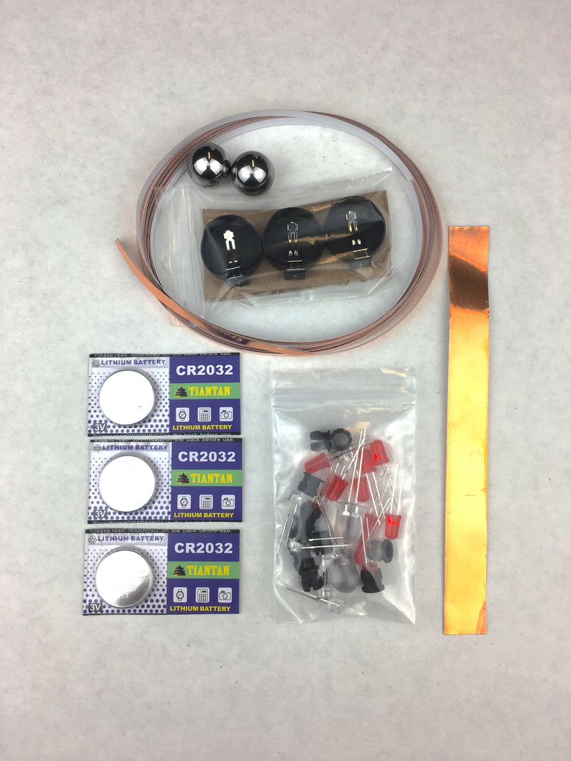 LED Teck Pack batteries, copper tape, battery holders, ball bearings, and LED lights