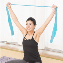 Woman Using Resistance Bands During Yoga