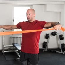 Elite Athelete Using Body Sport Resistance Bands at Home Gym