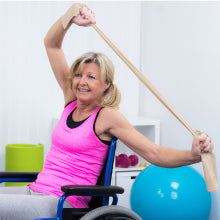 Woman in Wheelchair Using Body Sport Exercise Bands