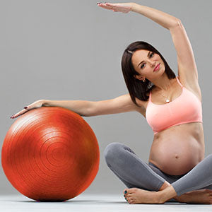BodyMed Fitness Ball - Pregnant woman working out with fitness ball