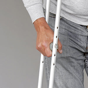 BodyMed Aluminum Crutches  - Man putting weight on crutches