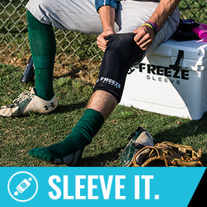Freeze Sleeve Cold Therapy Compression Sleeve - pulling up freeze sleeve on leg