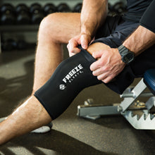 Freeze Sleeve Cold Therapy Compression Sleeve - close-up of pulling up freeze sleeve on over knee