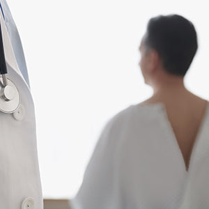 BodyMed Disposable Exam Gowns - back of patient with gown
