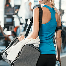 BodyMed Resistance Loop Tube - woman carrying a gym bag