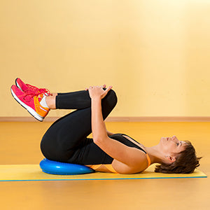BodySport Balance Disc - woman laying on disc