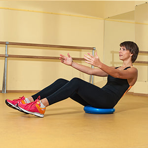 BodyMed Balance Disc - woman working out on disc reverse plank