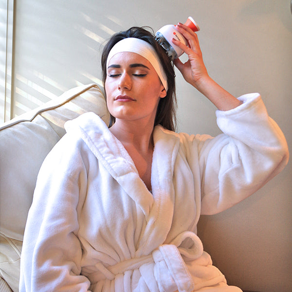 Personal spa massages at home with an electric scalp massager