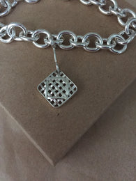 Farm Life Collection: Sterling Silver Charm Bracelet with Tobacco Medallion