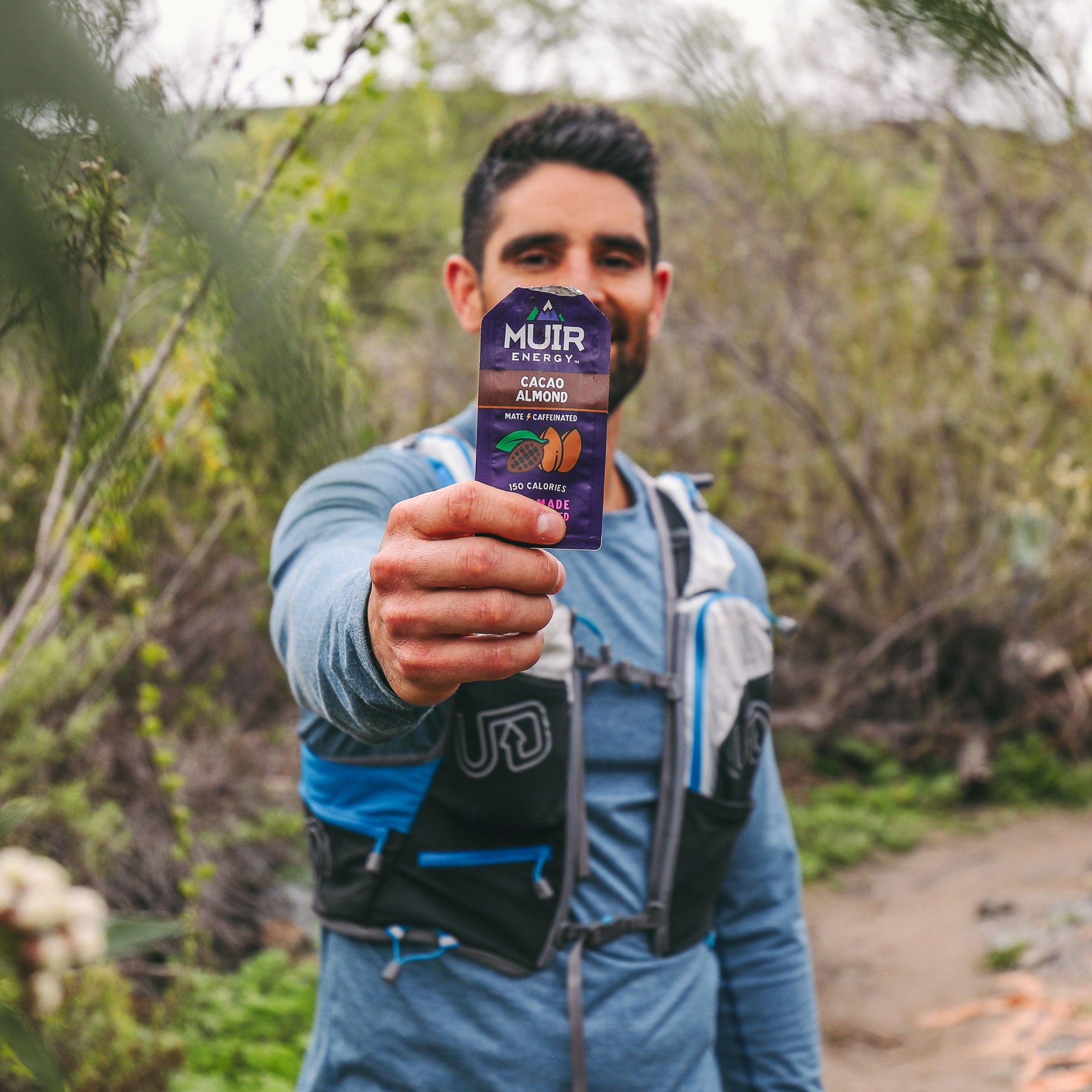 Muir Energy endurance athlete and trail runner eating Cacao Almond Mate.