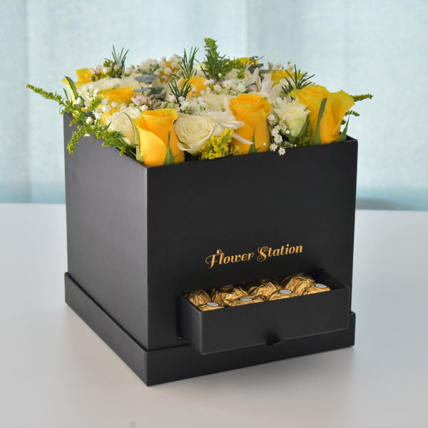 red roses in a black luxury box with ferrero rocher