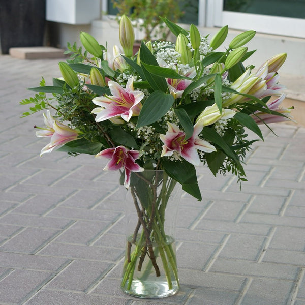 A beautiful bunch of lilies in a vase by Flower Station