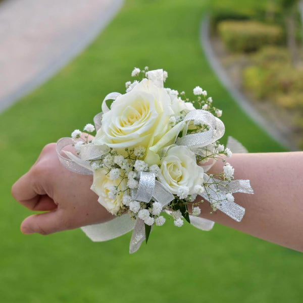 Fresh flower jewelry, corsage, bracelet by Flower Station