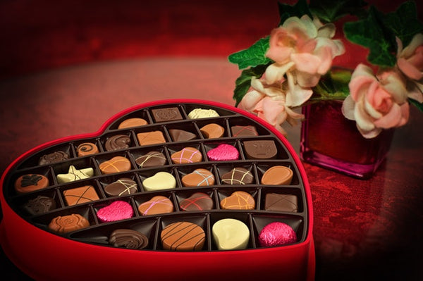 Box of chocolate and rose flowers