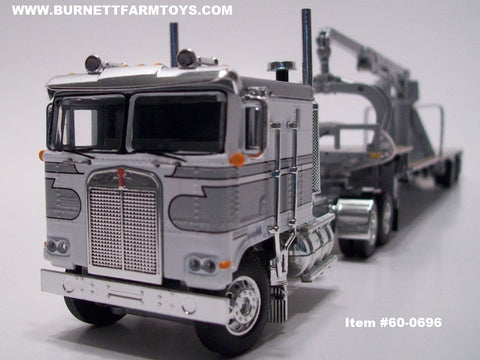 Item #60-0696 Silver White Long Frame Kenworth K100 COE Flattop Sleeper with Spread Axle Transcraft Stepdeck Trailer with Silver Boom Arm