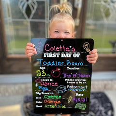 Little girl with sign for the first day of school