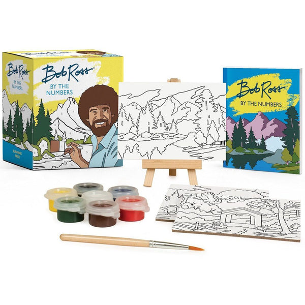 This Bob Ross paint by numbers kit includes three pre-printed canvases with easy-to-paint numbered sections, two landscapes, one paint pot with seven colors, one mini paint brush, one mini easel and a 32 page instruction book with full-color, fold-out sheets and painting tips.