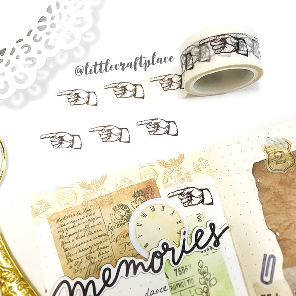 Pointing Finger washi tape. Perfect for rustic vintage journal spread, use this washi tape to add a touch of dimension and texture to creative projects. Beautifully designed and photo safe, it makes a great decorative accent on scrapbooks, cards, mixed media projects and more.