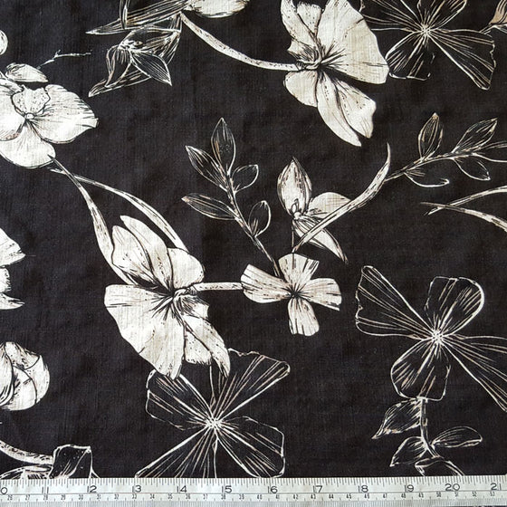Viscose/Cotton Blend White Floral on Black Background - The Fabric Bee