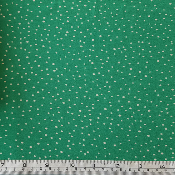 Polyester White Spots on Green Background - The Fabric Bee