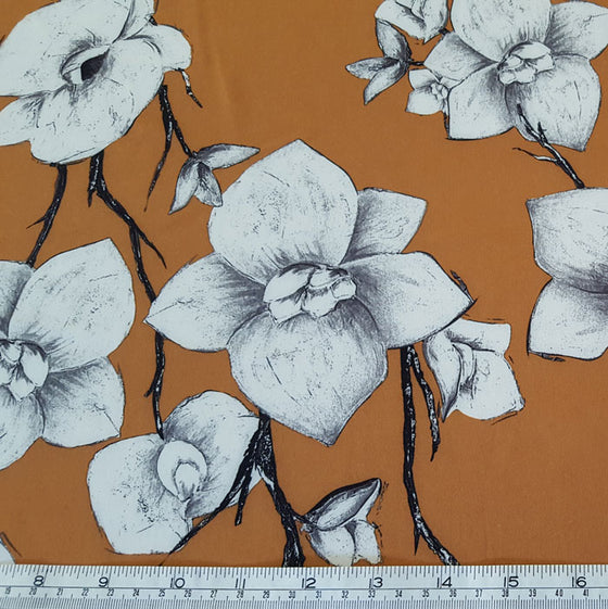 Polyester with Stretch Ivory Flower on Tan - The Fabric Bee