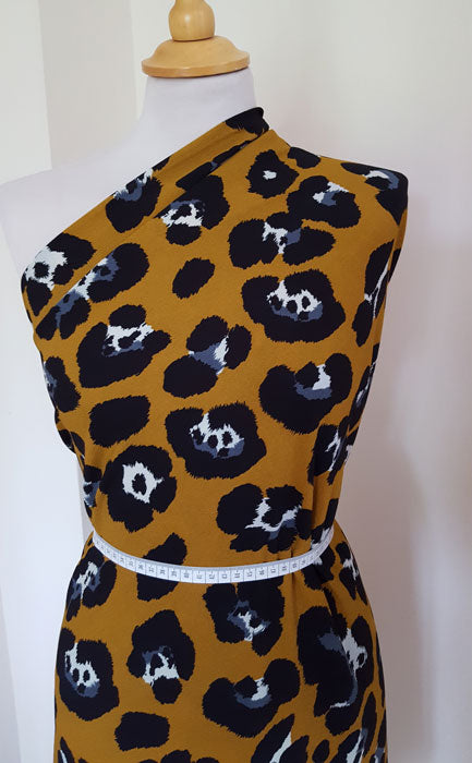 Polyester Animal Print on Mustard Background - The Fabric Bee