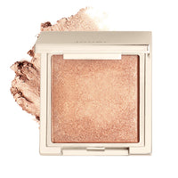 alt: tan lines highlighter (shimmering deep peachy bronze) compact