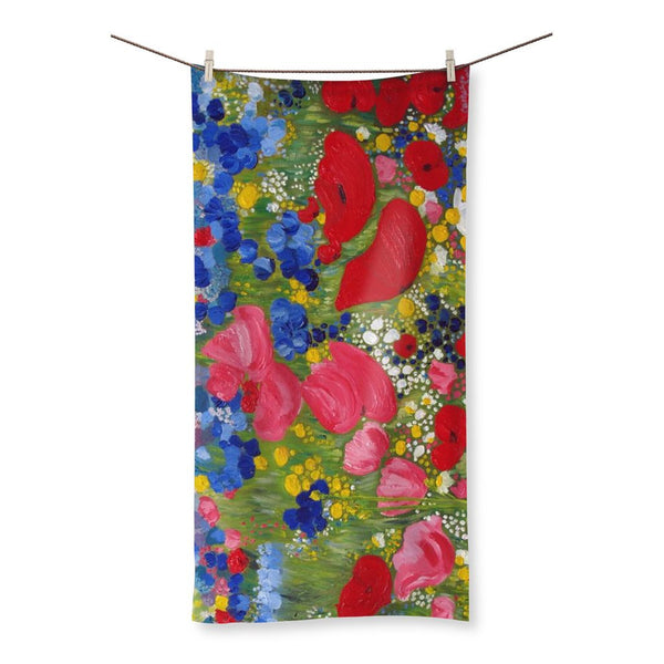 Rainbow in the meadow designed by Catherine Bhogal Beach Towel