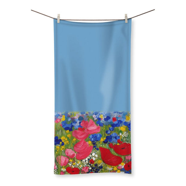 Rainbows in the meadow designed by Catherine Bhogal Beach Towel