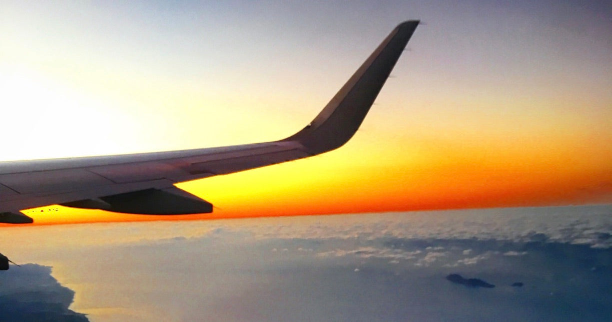 Airplane wing sunrise