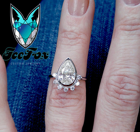 10x7mm, 2ct Pear Moissanite in a 14k White Gold Diamond Fantail Setting - In The IceBox