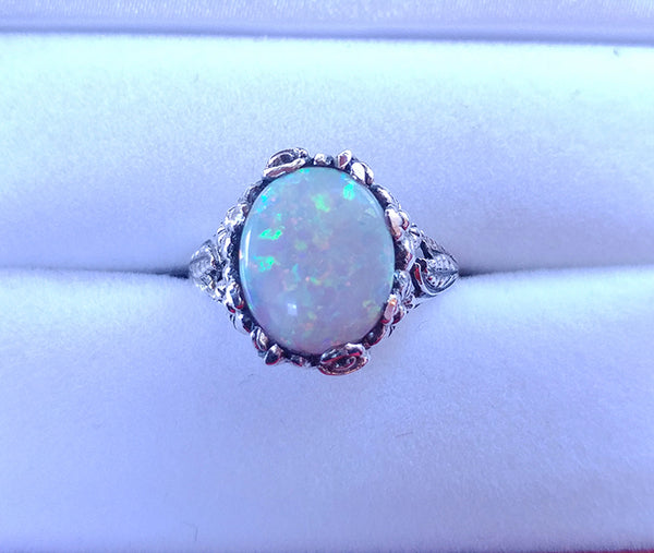 Opal - 12x10mm Oval Cabochon Opal in a 14k White Gold Floral Setting - In The IceBox
