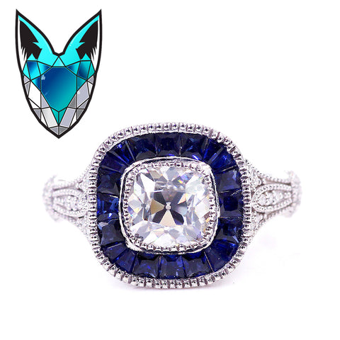 2.5ct, 8mm Old Mine Cut Moissanite Set in a 14K White Gold Blue Sapphire Halo Setting