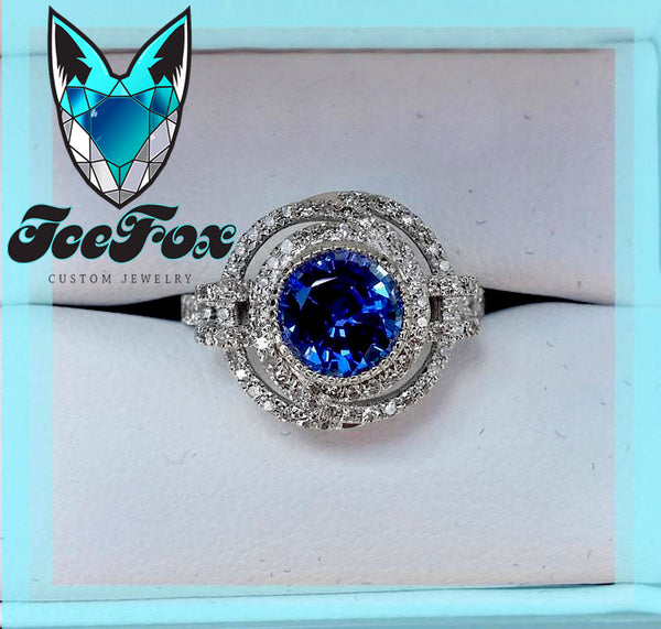 Sapphire - Cultured Blue Sapphire 6.5mm, 1.4ct Round bezel set in a 14K White Gold Knot Setting - In The IceBox