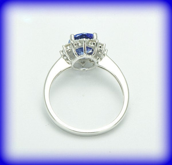 Tanzanite Oval Vintage Engagement Ring in a 14K White Gold Diamond Halo Setting