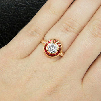 Moissanite Ruby Engagement Ring 1ct Round Moissanite set in an 14k Rose Gold Ruby Halo Setting