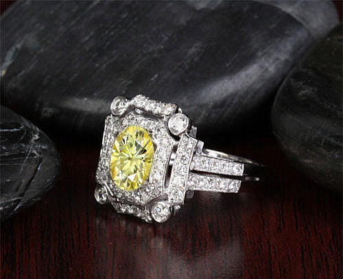 Oval Cut Canary Yellow Moissanite  in a 14K White Gold Diamond Art Deco Halo Setting