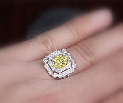 Oval Cut Canary Yellow Moissanite  in a 14K White Gold Diamond Art Deco Halo Setting - The IceFox