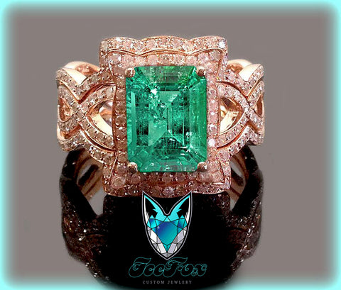Emerald - 8 x 10mm 3.5ct Cultured Included Emerald in a 14k Rose Gold Diamond Halo Setting with two matching bands