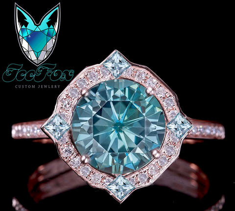 Moissanite - Caribbean Blue 2ct. 8mm Blue Round Brilliant set in an 14k Rose Gold Diamond and Aquamarine Halo Setting - In The IceBox